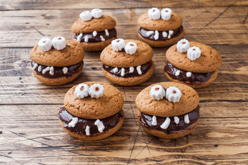 Cookies with chocolate paste in the form of monsters for Halloween