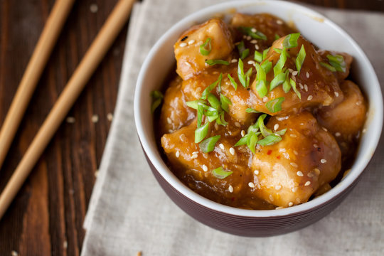 Homemade chicken breasts in orange sauce