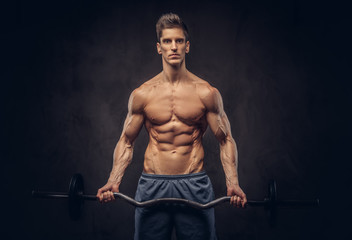 Handsome shirtless man with stylish hair and muscular ectomorph