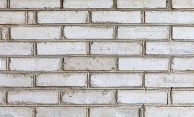 White brick wall background. Vintage brickwork abstract object, gray seam.