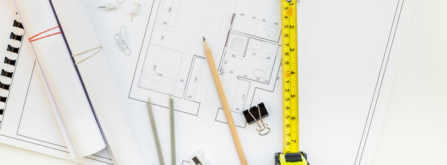 Interior designer table workplace with house plan