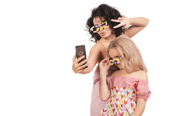 Funny Mom and daughter do selfie. Isolated on white background.
