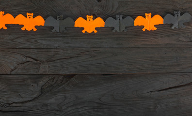 concept of a Halloween holiday on a black wooden background