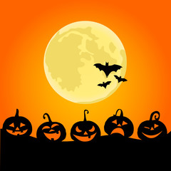 Halloween night background with pumpkins and the full moon
