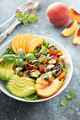 Avocado peach caprese salad with basil pesto