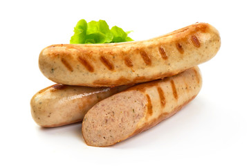 Grilled Munich sausages with green lettuce, isolated on white background.