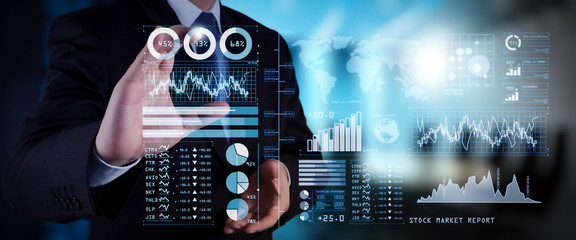 Investor analyzing stock market report and financial dashboard with business intelligence (BI), with key performance indicators (KPI).businessman hand working with finances program