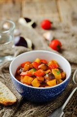 Eggplant potato Bell pepper goulash with bread slices
