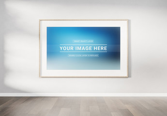 Wooden Frame Hanging On Wall Mockup
