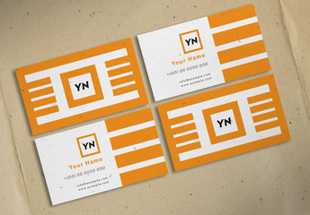 Business Card Layout with Orange Geometric Elements