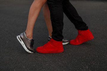 Fashion sneakers close-up. Couple Hug and kiss