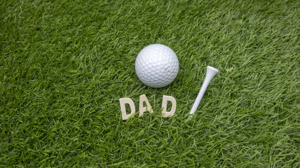 Golf with Dad word on green grass for golfer's father day