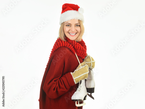 dfe72eb5855 Woman in winter clothes with ice skates. Smiling cheerful girl in Santa  Claus hat