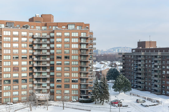 Modern condo buildings with huge windows in snow, Montreal, Canada.