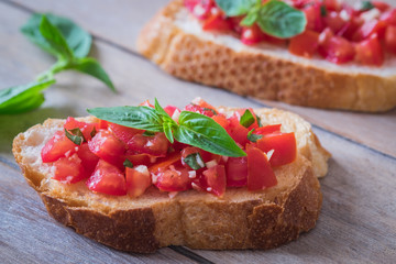 Bruschetta bread with chopped tomato and basil