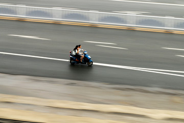 A motorcycle speeding along the road