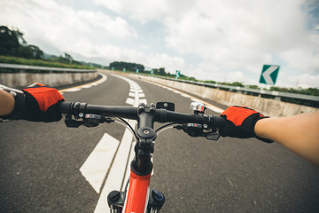 Free rider Cyclist Riding Mountain Bike on highway