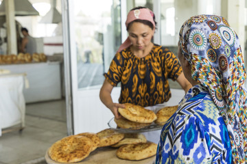 Traditional uzbekistan bread lavash at local bazaar, is a soft flat-bread of Middle Asia (Uzbekistan).