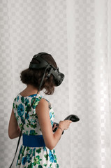 Girl in dress plays in virtual reality