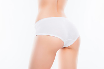 Close up photo of fit woman's ass with perfect ideal skin in whi