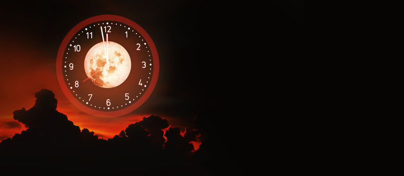 Artistic Halloween background on midnight time scary theme with blood moon and red sky evil clouds background.