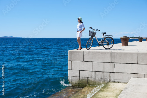 Pretty Slim Tourist Girl In White Clothing And Sunglasses Standing