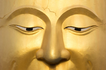 The face of the Buddha gold thailand.Background and Texture