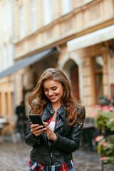Woman Using Phone On Street