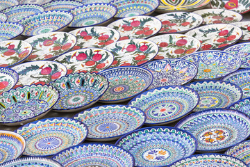 Plates and pots on a street market in the city of Bukhara, Uzbekistan.Traditional souvenir.