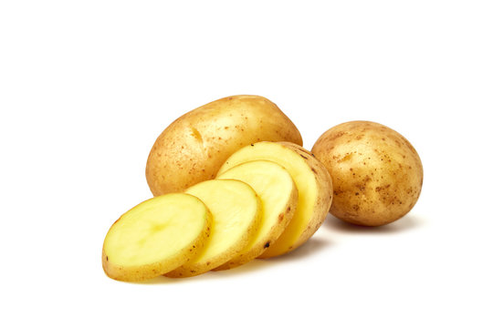 Potatoes. Fresh natural potatoes isolated on white background. Sliced potatoes