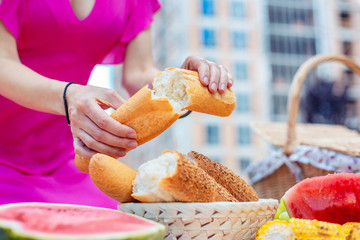 Fototapeten Brot Just baked. Loaf of freshly baked bread being in female hands