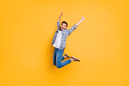 Full-size portrait of happy excited young man screaming and jump