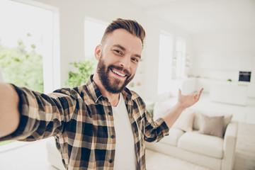 Welcome Brunet man take selfie on front camera of modern smartp