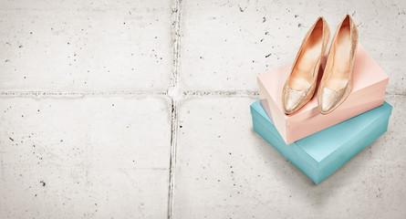 Pair of elegant metallic gold high heeled shoes