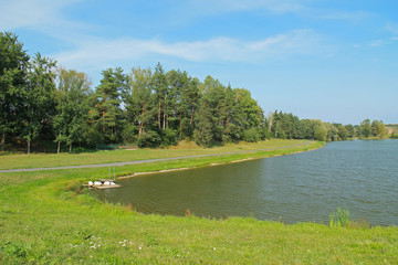 nice pond with the trees on its bank in summer, Brusperk, Czech Republic