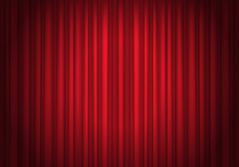 Red curtains background illuminated by a beam of spotlight