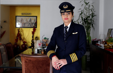 Shweta Singh, a Jet Airways pilot, poses for a picture inside her house in Gurugram
