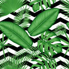 Wall Mural - Beautiful seamless vector floral pattern tropical jungle leaves on a geometric background