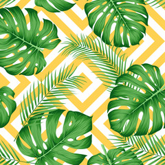 Wall Mural -  Exotic pattern with tropical leaves on a geometric background with yellow rhombuses