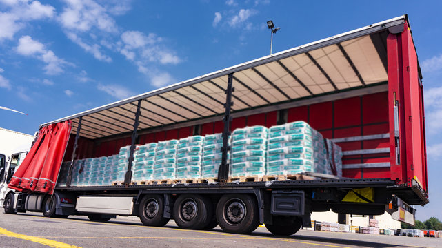 There is a loading to the truck trailer . Truck Trailer  . Cargo Transportation . Lorry horizontal .  Concept of wholesale  . fastening of freight in the trailer . distribution warehouse