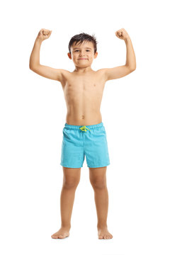 Little boy in swimwear showing muscles