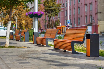 The beautiful sunny cityscape with four benches on the sidewalk. Russia, Rostov-on-Don Fotomurales