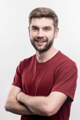 Blue-eyed man. Image without face retouching with bearded blue-eyed handsome man feeling excited and cheerful
