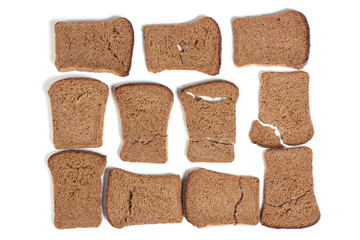 Slices of dried rye bread on white background
