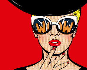 Pop art thinking woman in black hat in glasses.Wow female face.Saxy amazed yong girl with open mouth