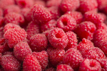 Raspberry fresh and sweet on wooden background close up
