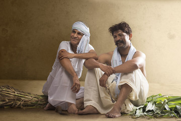 Two Indian farmer sitting together