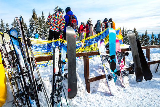 skis and snowboards in the snow. Rental of skis and snowboards in the mountains.