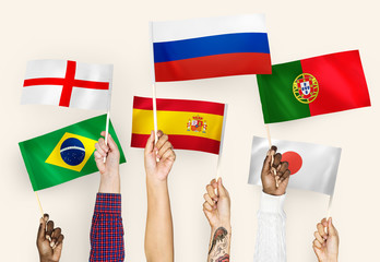 Hands waving the flags of England, Spain, Japan, Portugal, Russia, and Brazil