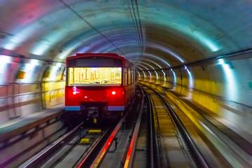 Metro train in subway underground tunnel